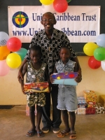Pastor distributing the Make Jesus Smile shoeboxes in Brokoponda