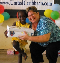 Kim Smith distributing the Make Jesus Smile shoeboxes in Brokoponda