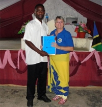 Seen here receiving his KIMI manual and curriculum from Jenny Tryhane, founder of UCT and a KIMI leadership trainer.