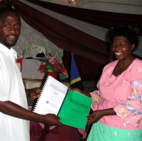 This Pastor receiving her manual and curriculumm from Pastor David was one of the House of Freedom Women's Empowerment program and she is excited about introducing the program into her local schools.