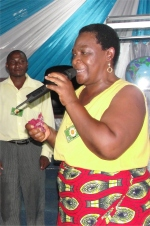 Bishop's wife leading the demo PowerClub at the end of their Tanzania KIMI Leadership training