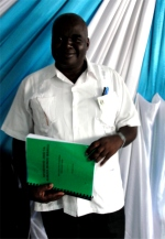 Bishop seen at Tanzania Calvary Tabernacle Church receiving his KIMI curriculum.