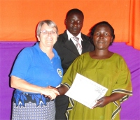 Bishop and his wife receiving their KIMI certificates at the end of the Tunduma KIMI PowerClub Leadership Training March 2011.