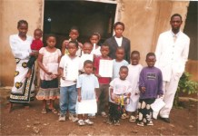 Pastor Lotie, Stella and the Sunday School teacher with some of the children