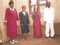 Pastor Lotie seen here In the white suit with one of the new church member Sister Karin (she is from Germany,) in black suit is Stella, his wife, followed by one of the church member.