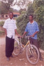 Pastor Lotie and Pastor William seen here with the mountain bike donated by UCT to start the Youth Alert AIDS educational program at Liberty School.