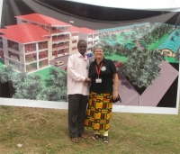 Seen here with Pastor Abraham, the UCT Uganda representative at Prayer Mountain for all Nations in front of their vision for a Prayer Village.