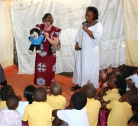 Pastor Laura with her friend 'Goodie Bear' addressed the children
