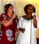 Pastor Martina translating for Pastor Laura as she brought the Word on Sunday at the CEPCI church in Kampala.
