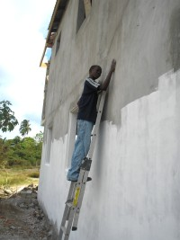 Sammy seen here, age 12 painting the back of the church