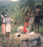 Bathing by the well in Bequia
