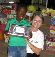 As the shoe boxes were distributed the children were photographed and documented to help establish the Suriname Child Sponsorship Program.