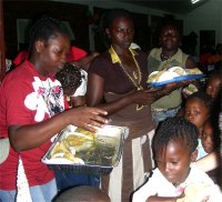 Chicken curry and roti had been prepared and after the party every child left with food and popcorn