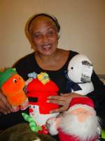 United Caribbean co-ordingator Dawnay with toys for the children of Grenada